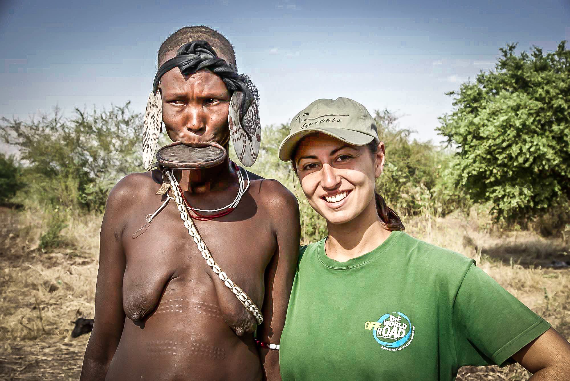 Vula with an old Mursi woman in Omo valley, Ethiopia