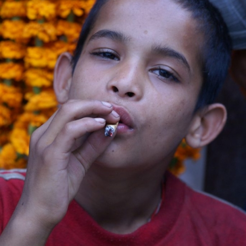 The smoking boy in the Durbar Sq. of Kathmandu, Nepal