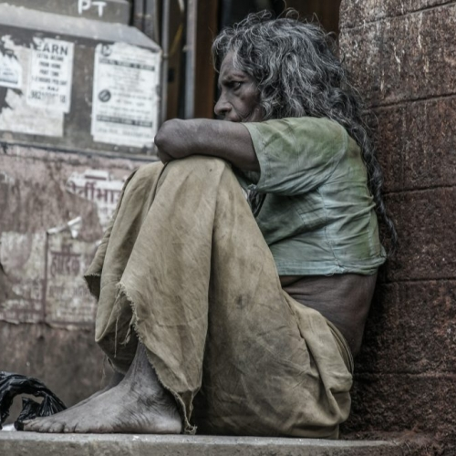 Homeless woman in front of Bombay train station